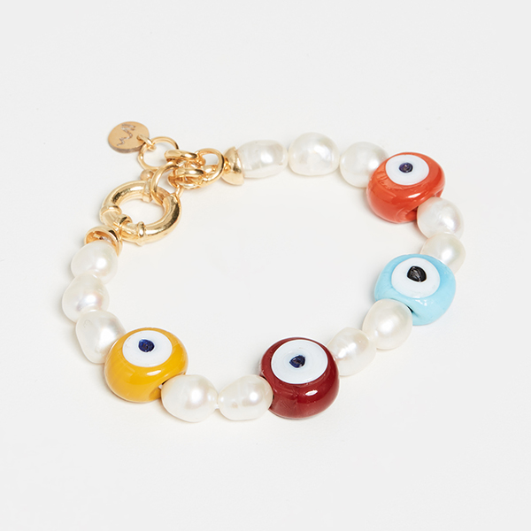 A pearl bracelet punctuated by colorful beads.