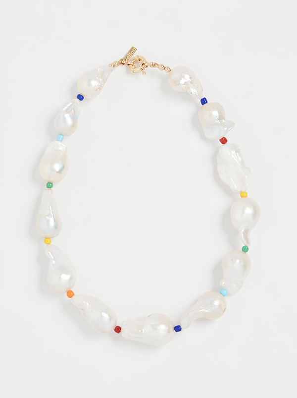 Pearl necklace punctuated by rainbow beads.