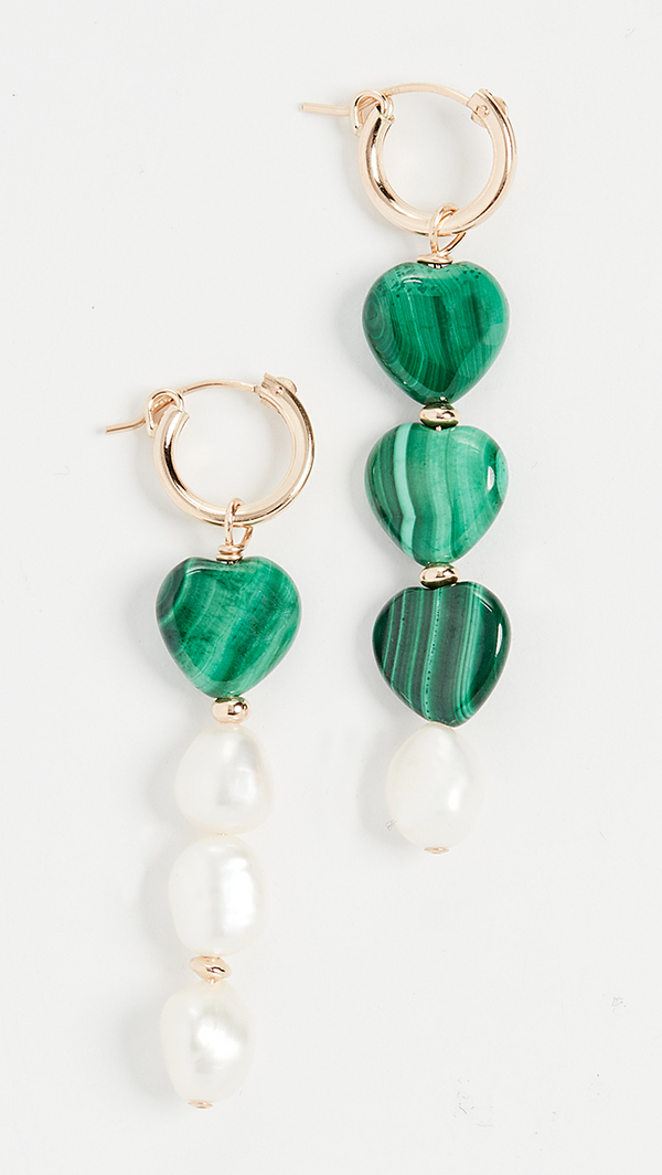 A pair of asymmetrical drop earrings featuring green beads and pearls.