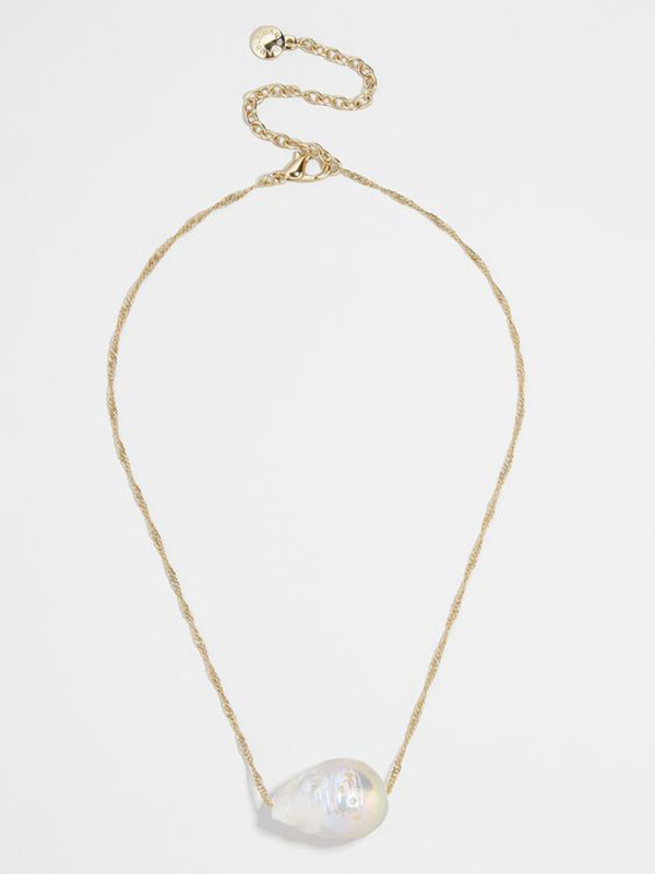 A pearl pendant necklace on a tight gold chain.