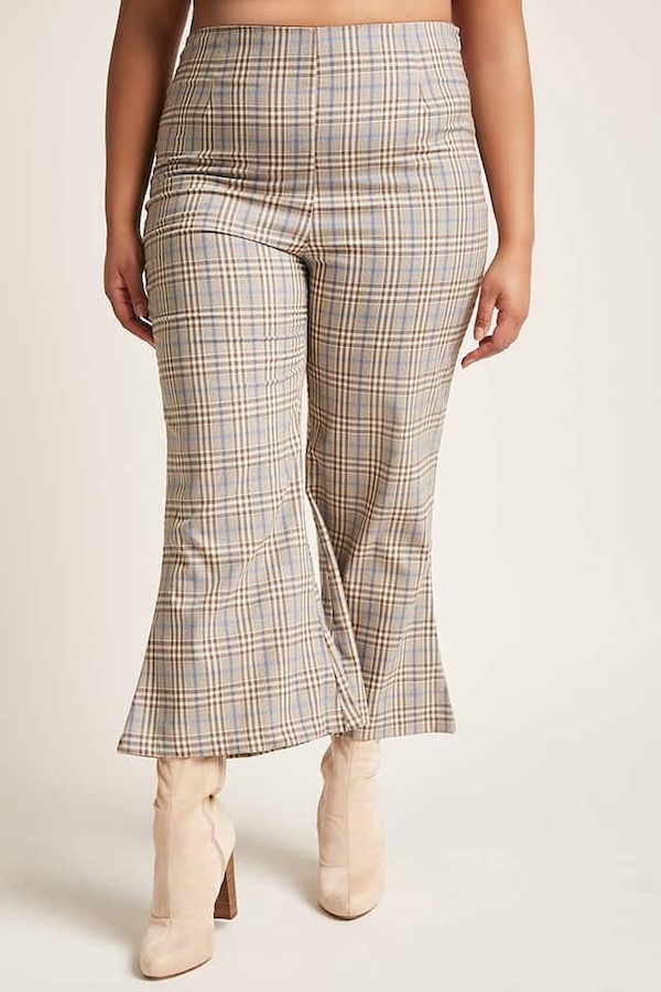 A woman wearing plaid flare pants.