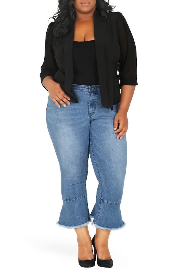 A woman wearing denim flare cropped pants.