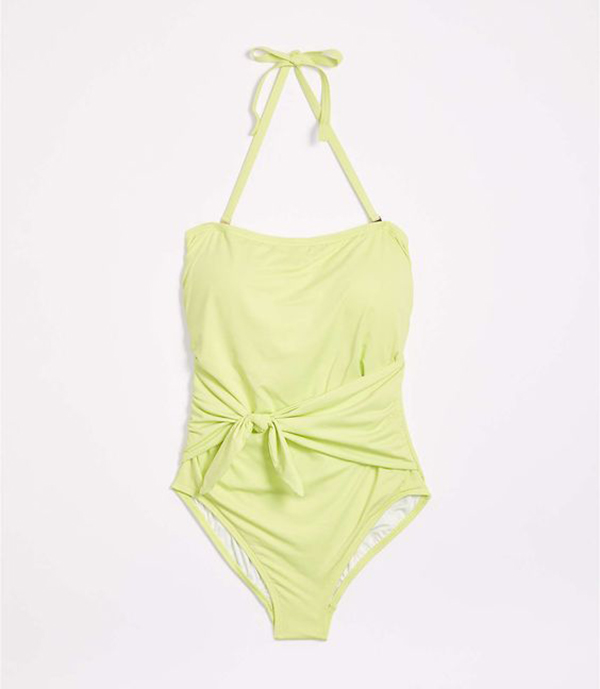 A plus-size, light yellow-green one-piece swimsuit.
