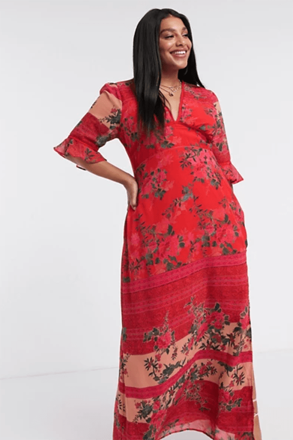 A plus-size model wearing a red patchwork maxi dress.