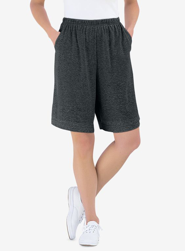 A model wearing charcoal gray sweat shorts.