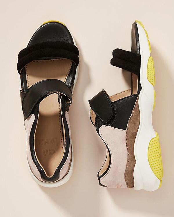 A black, velcro-strapped sneaker sandal.