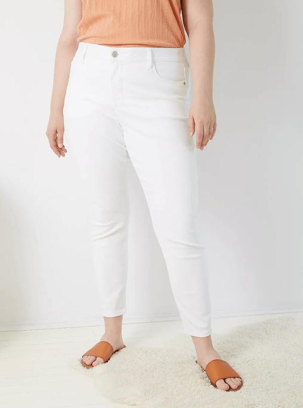 A woman wearing white jeans.