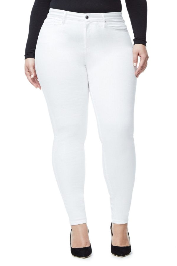 A woman wearing white skinny jeans.