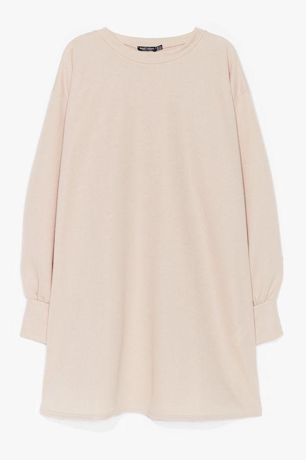 A light tan sweatshirt dress.