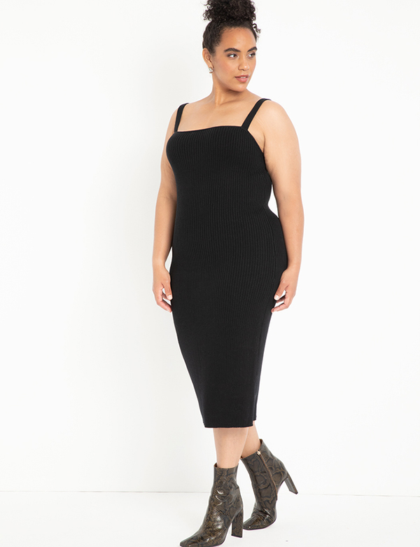A plus-size model wearing a black dress, which is now on sale at Eloquii for less than $29.