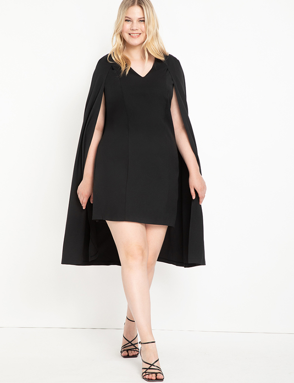 A plus-size model wearing a black cape dress, which is now on sale at Eloquii for less than $39.