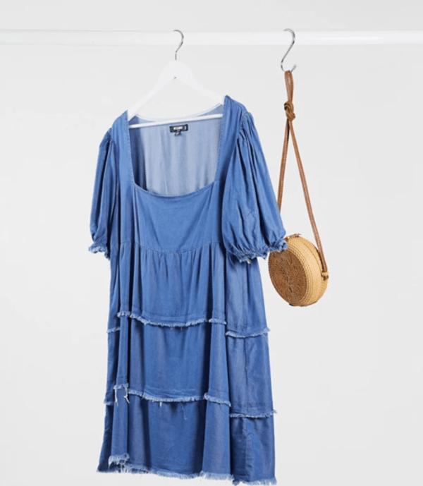 A plus-size puff-sleeve denim dress.