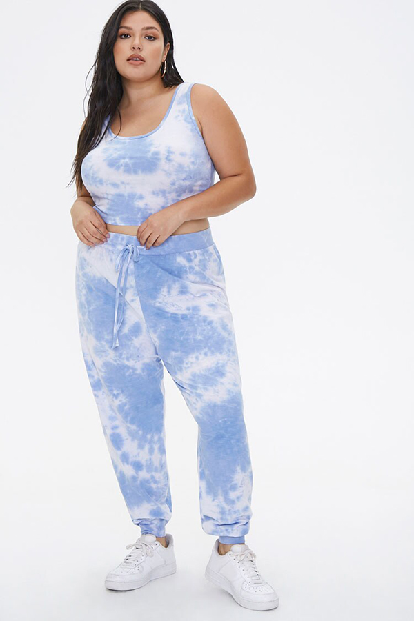 A plus-size model wearing a blue tie-dye lounge set.