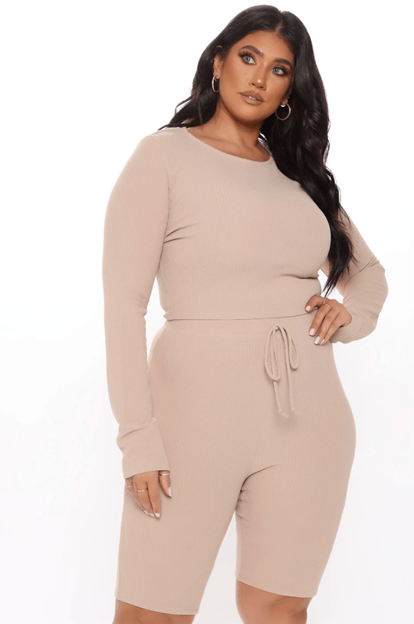 A plus-size model wearing a taupe lounge set.