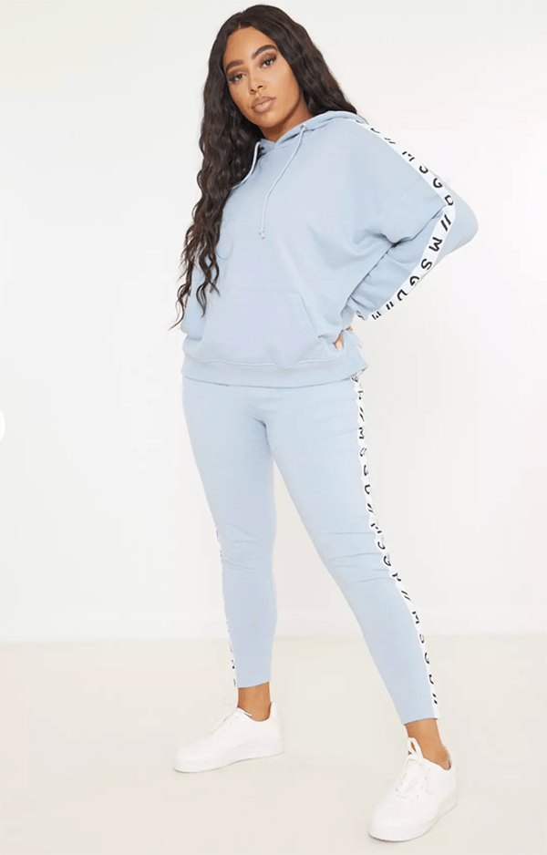 A plus-size model wearing a light blue lounge set.