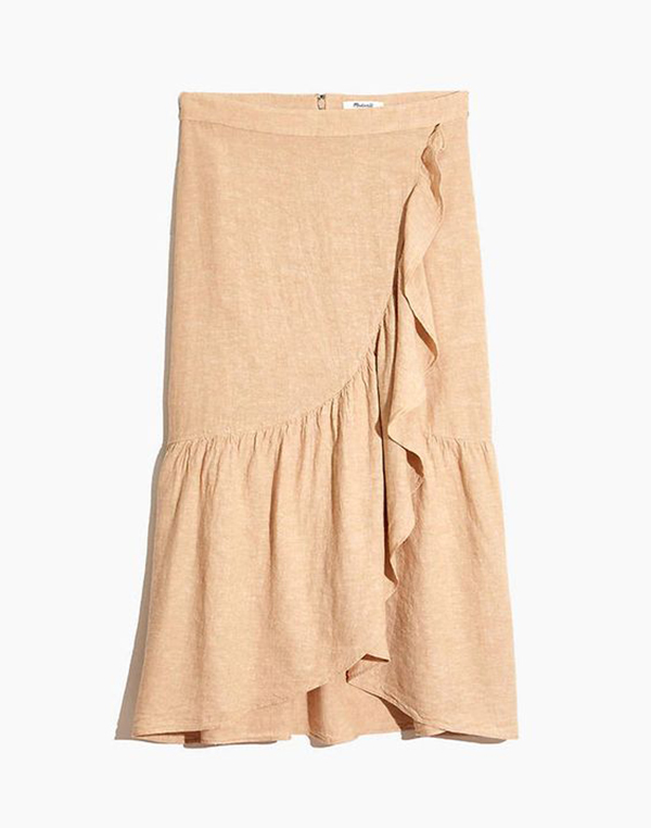 A plus-size beige wrap midi skirt.