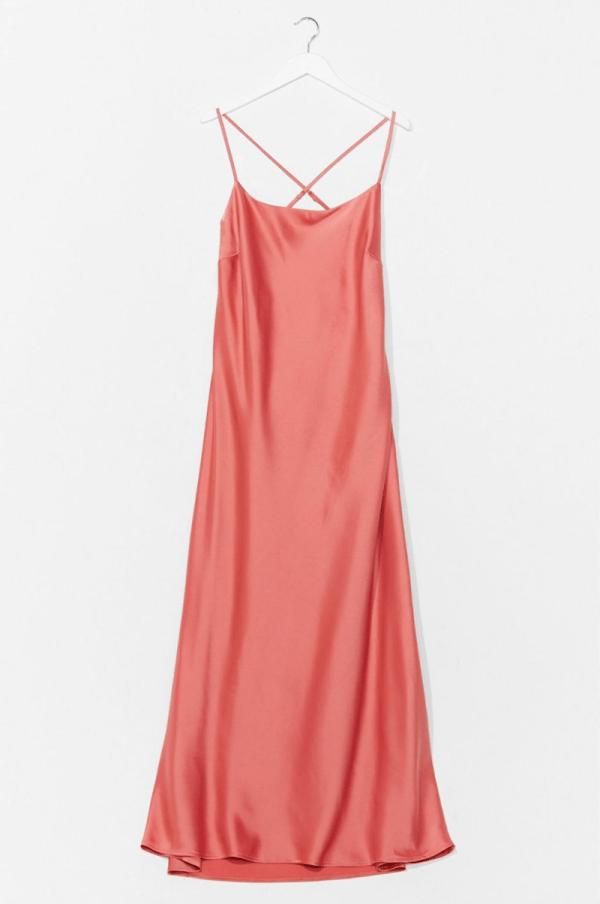 A plus-size blush pink maxi slip dress.