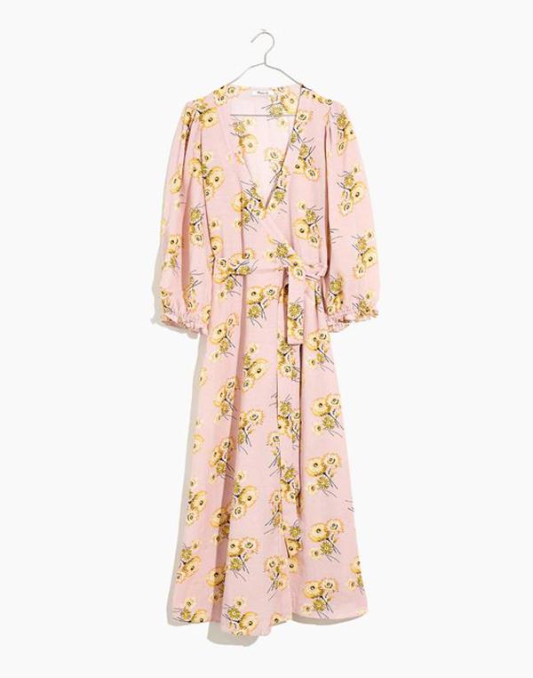 A plus-size pink floral wrap dress.