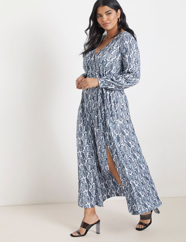 A plus-side model wearing a blue snake print wrap dress.