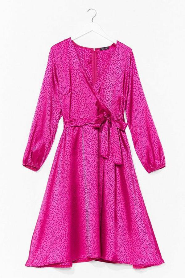 A plus-size hot pink satin wrap dress.
