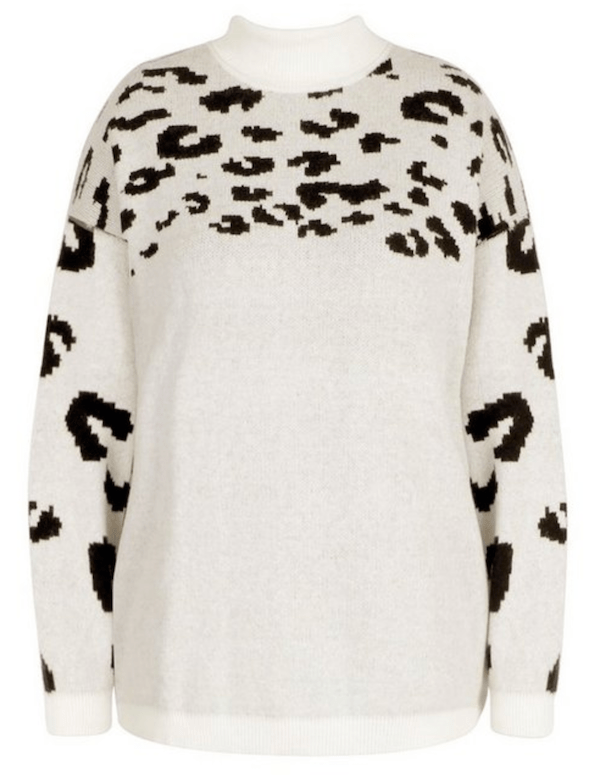 A white and black leopard print sweater.
