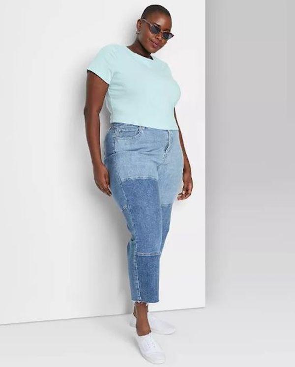 A model wearing a plus-size crop top.