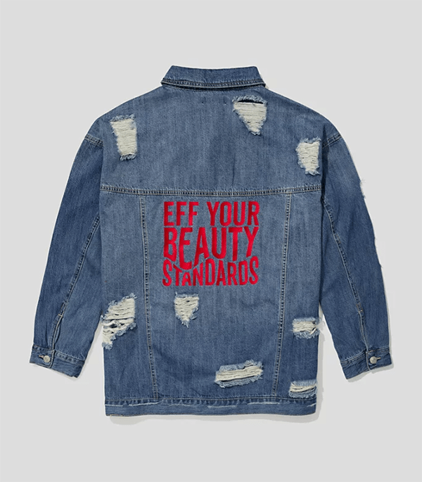 "A plus-size denim jacket with the phrase ""Eff your beauty standards"" embroidered on the back."