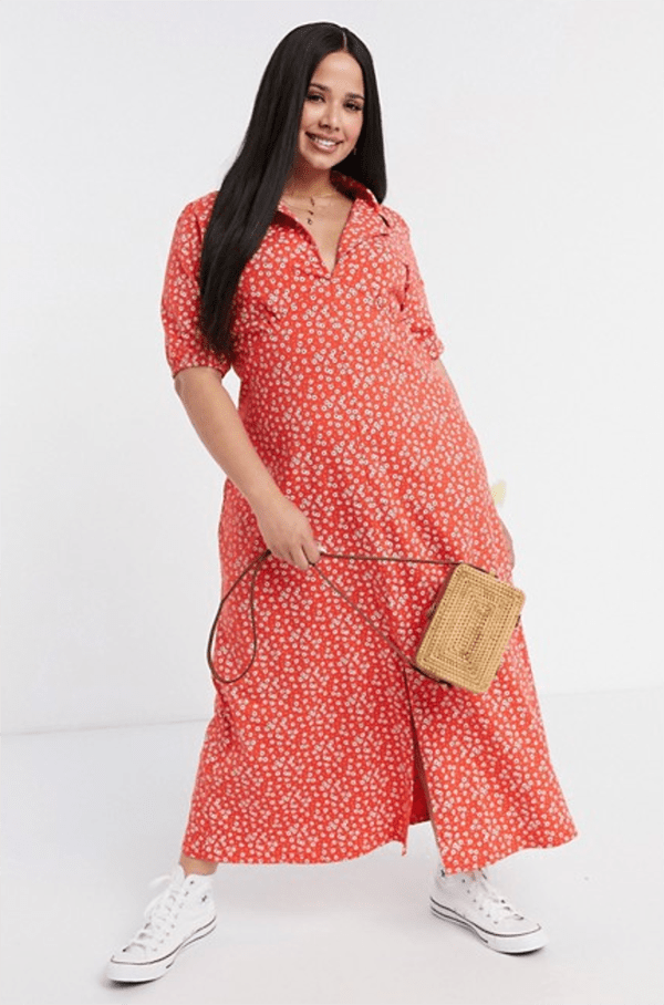 A plus-size model wearing a red printed fall maxi dress.