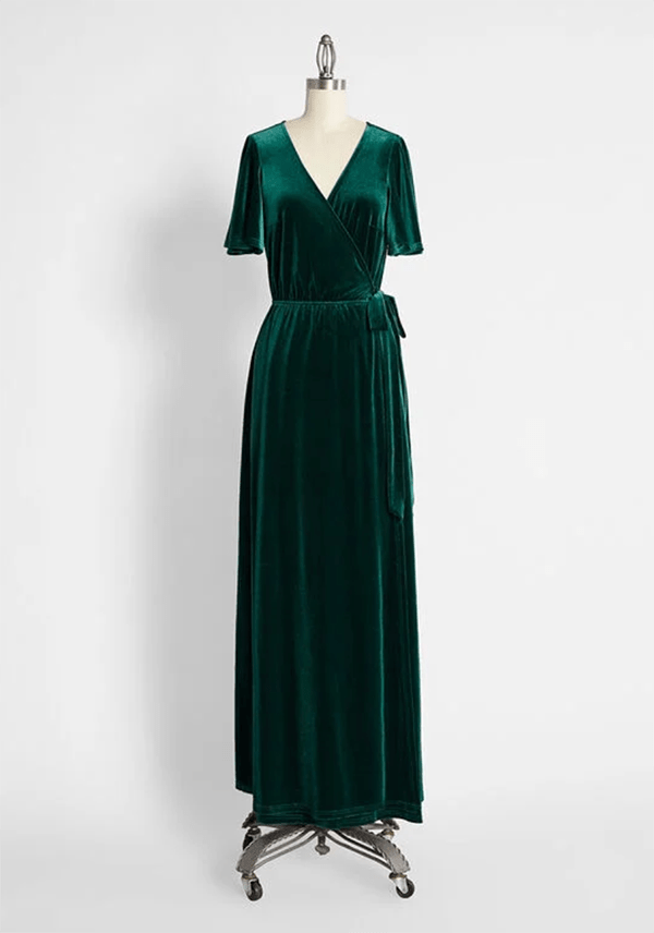 A plus-size dark green velvet fall maxi dress.