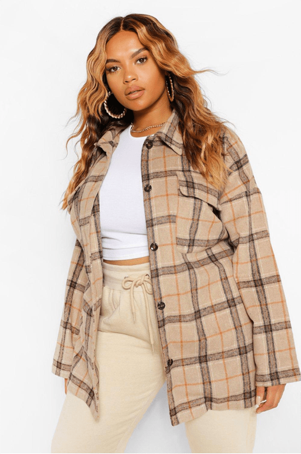 A plus-size model wearing a plaid shacket.