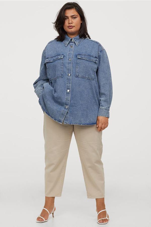 A plus-size model wearing a denim shacket.