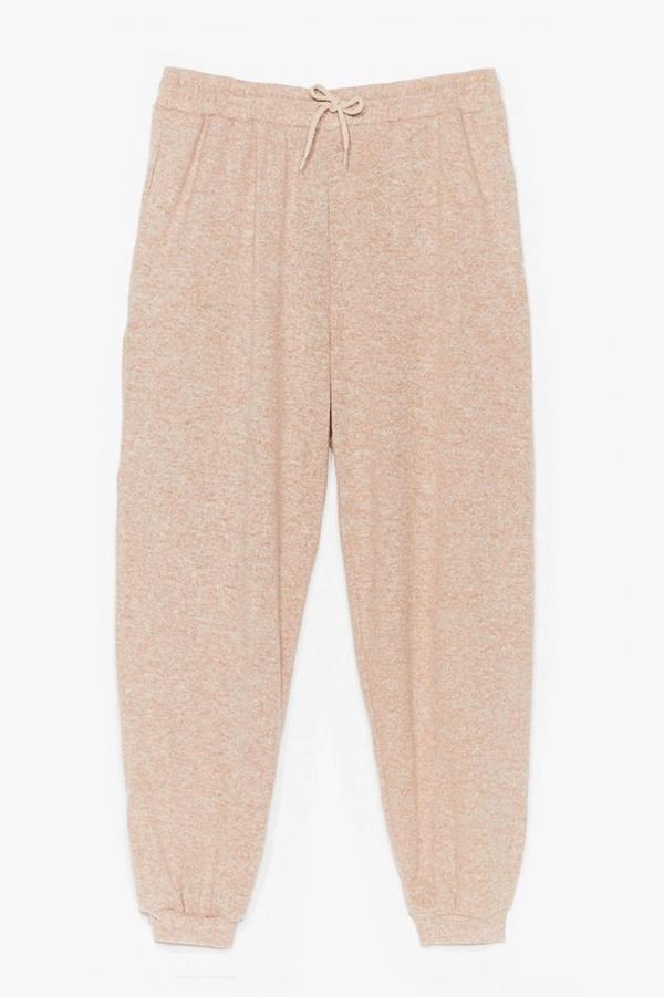 Plus-size oatmeal colored sweatpants.