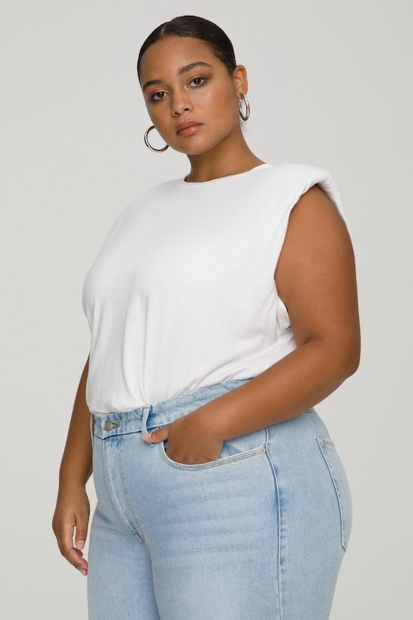 A model wearing a plus-size shoulder pad tank.