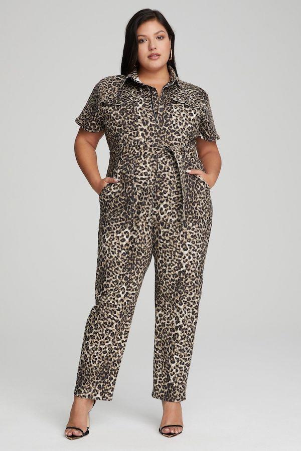 A model wearing a plus-size utility jumpsuit in leopard print.