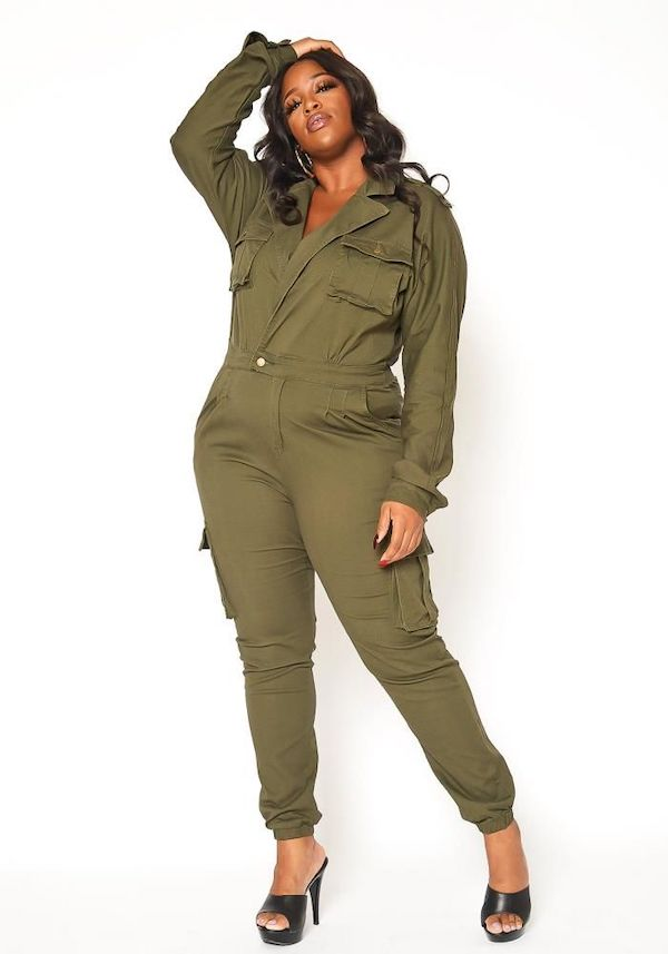 A model wearing a plus-size utility jumpsuit in olive green.