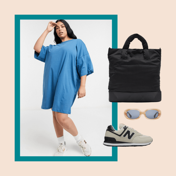 A plus-size model wearing a t-shirt dress, black bag, sunglasses, and sneakers.