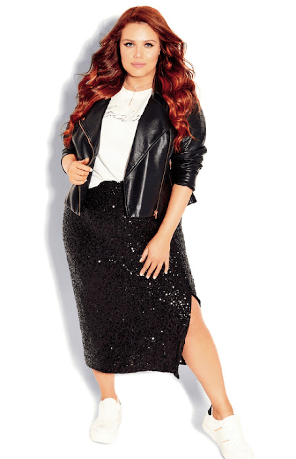 A plus-size model wearing a black sequin skirt.