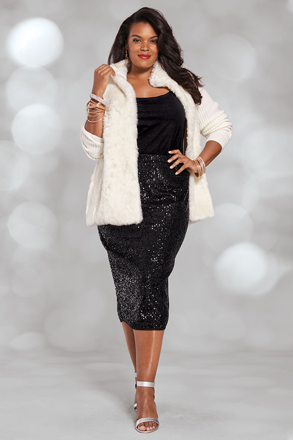A plus-size model wearing a black sequin midi skirt.