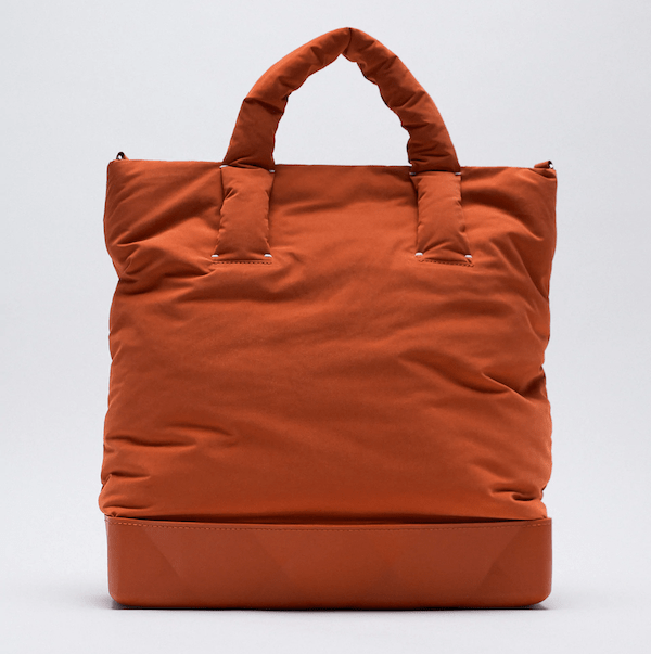 A burnt orange puffer tote.