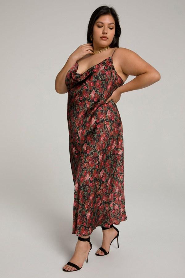 A plus-size model wearing a sexy floral slip dress.