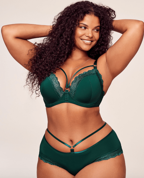 A plus-size model from Adore Me wearing a green lingerie set.