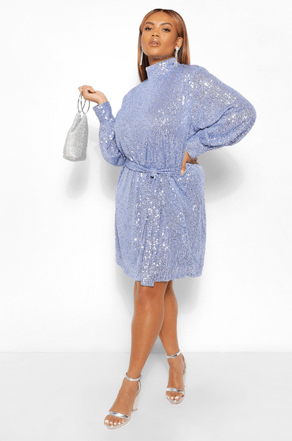 A plus-size model wearing a blue sequin dress, which will be on sale at Boohoo's 2020 Black Friday sale.