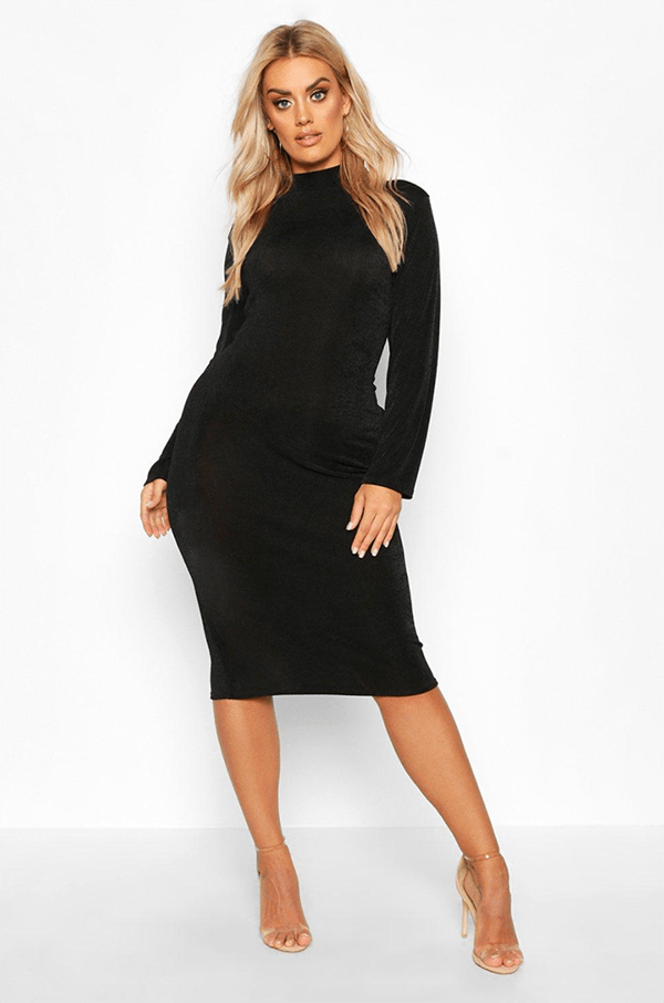 A plus-size model wearing a black midi dress, which will be on sale at Boohoo's 2020 Black Friday sale.
