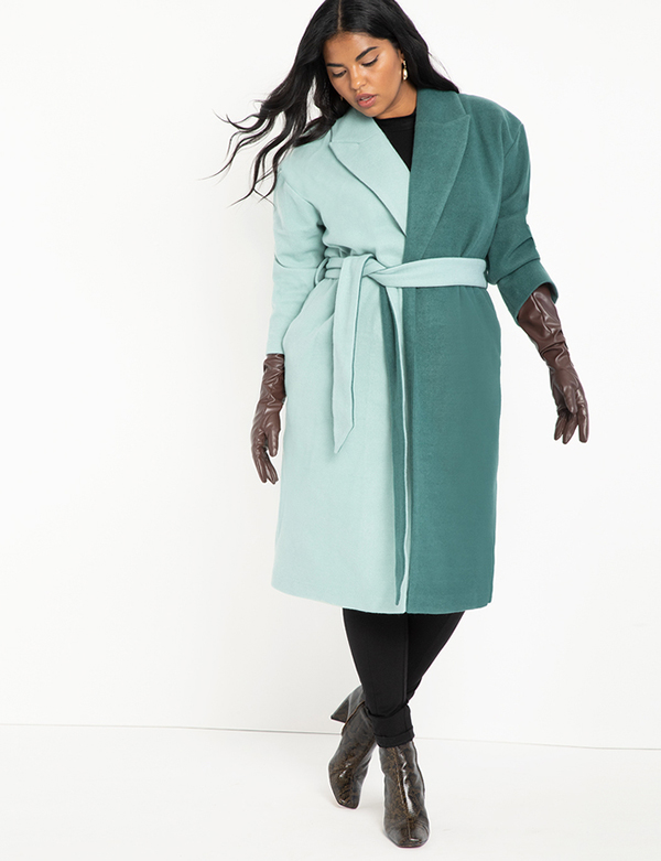 A plus-size model wearing a colorblock coat, which will be marked down at Eloquii's 2020 Black Friday sale.