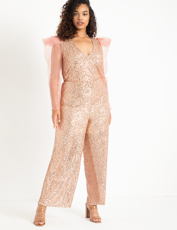A plus-size model wearing a pink sequin jumpsuit, which will be marked down at Eloquii's 2020 Black Friday sale.