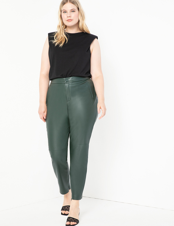A plus-size model wearing green leather pants, which will be marked down at Eloquii's 2020 Black Friday sale.