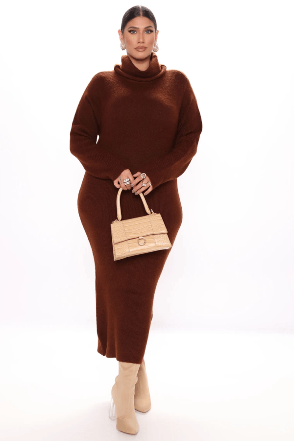 A plus-size model from Fashion Nova wearing brown sweater maxi dress.