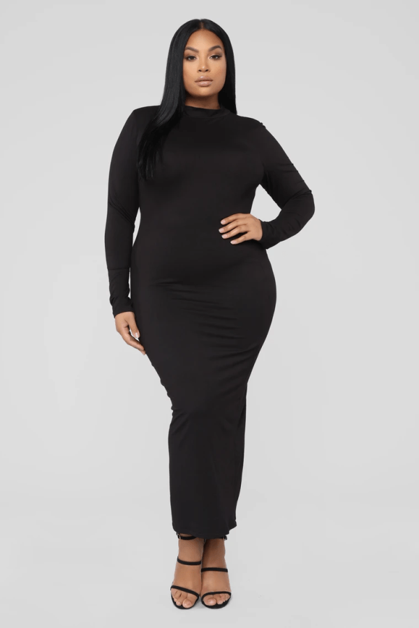 A plus-size model from Fashion Nova wearing a black bodycon maxi dress.