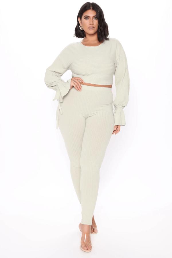 A plus-size model from Fashion Nova wearing a cream lounge set.
