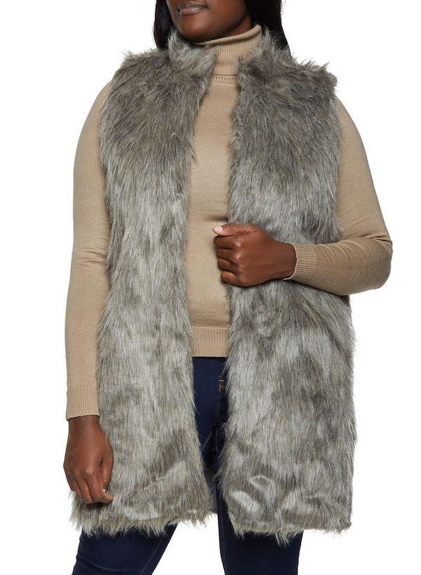 A plus-size model wearing a gray faux fur vest.